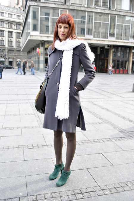 Green boots, gray coat, brown tights